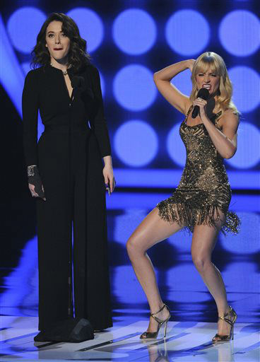 "<div class=""meta image-caption""><div class=""origin-logo origin-image ""><span></span></div><span class=""caption-text"">Hosts Kat Dennings, left, and Beth Behrs speak on stage at the 40th annual People's Choice Awards at the Nokia Theatre L.A. Live on Wednesday, Jan. 8, 2014, in Los Angeles.   (Photo/Chris Pizzello)</span></div>"