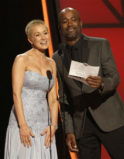 "<div class=""meta ""><span class=""caption-text "">Kellie Pickler, left, and Darius Rucker present the award for Song of the Year at the 46th Annual Country Music Awards at the Bridgestone Arena on Thursday, Nov. 1, 2012, in Nashville, Tenn. (Photo by Wayde Payne/Invision/AP) (Photo/Wayde Payne)</span></div>"