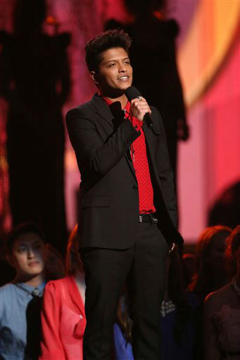 Bruno Mars speaks on stage at the 56th annual Grammy Awards at Staples Center on Sunday, Jan. 26, 2014, in Los Angeles. &#40;Photo by Matt Sayles&#47;Invision&#47;AP&#41; <span class=meta>(Photo&#47;Matt Sayles)</span>