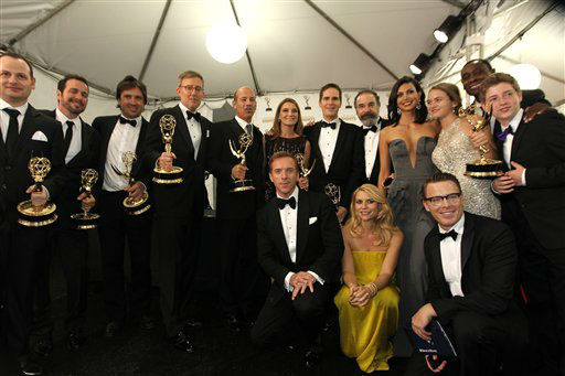 The cast of &#34;Homeland&#34;, winner, Outstanding Drama Series pose backstage at the 64th Primetime Emmy Awards at the Nokia Theatre on Sunday, Sept. 23, 2012, in Los Angeles. &#40;Photo by Matt Sayles&#47;Invision&#47;AP&#41; <span class=meta>(Photo&#47;Matt Sayles)</span>