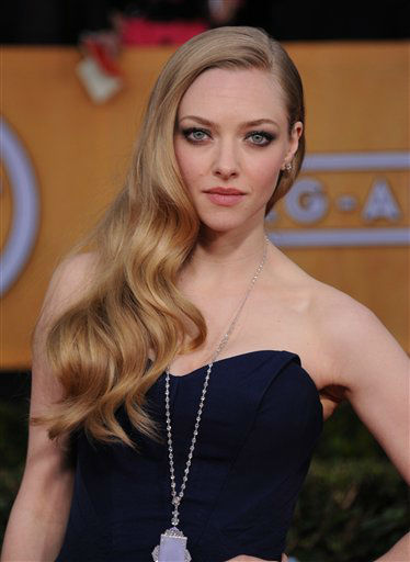 "<div class=""meta ""><span class=""caption-text "">Amanda Seyfried arrives at the 19th Annual Screen Actors Guild Awards at the Shrine Auditorium in Los Angeles on Sunday Jan. 27, 2013.   (Photo/Jordan Strauss)</span></div>"
