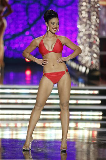 "<div class=""meta ""><span class=""caption-text "">Miss Iowa Mariah Cary competes in the swimsuit portion of the Miss America 2013 pageant on Saturday, Jan. 12, 2013, in Las Vegas.  (AP Photo/ Isaac Brekken)</span></div>"