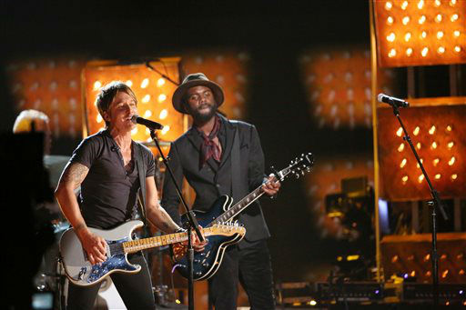 Keith Urban, left, and Gary Clark, Jr. perform &#34;Cop Car&#34; on stage at the 56th annual Grammy Awards at Staples Center on Sunday, Jan. 26, 2014, in Los Angeles. &#40;Photo by Matt Sayles&#47;Invision&#47;AP&#41; <span class=meta>(Photo&#47;Matt Sayles)</span>