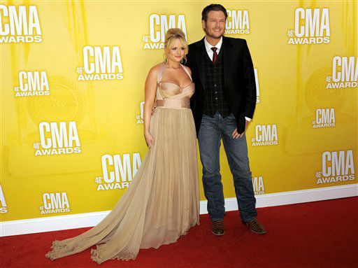 "<div class=""meta ""><span class=""caption-text "">Miranda Lambert, left, and Blake Shelton arrive at the 46th Annual Country Music Awards at the Bridgestone Arena on Thursday, Nov. 1, 2012, in Nashville, Tenn.   (Photo/Chris Pizzello)</span></div>"