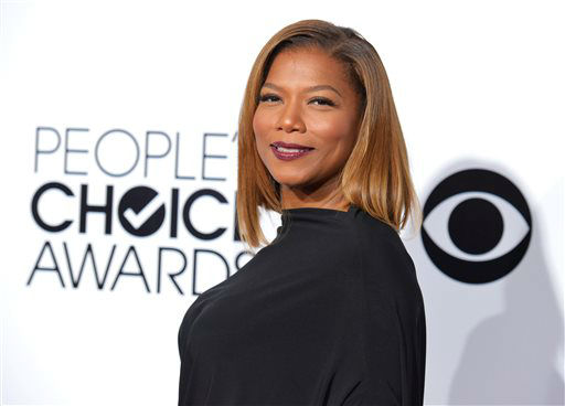 "<div class=""meta image-caption""><div class=""origin-logo origin-image ""><span></span></div><span class=""caption-text"">Queen Latifah arrives at the 40th annual People's Choice Awards at Nokia Theatre L.A. Live on Wednesday, Jan. 8, 2014, in Los Angeles.  (Photo/John Shearer)</span></div>"