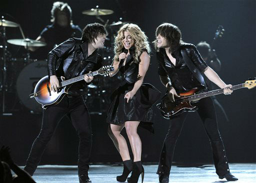From left, Neil Perry, Kimberly Perry and Reid Perry, of musical group The Band Perry, perform at the 48th Annual Academy of Country Music Awards at the MGM Grand Garden Arena in Las Vegas on Sunday, April 7, 2013. <span class=meta>(AP photo)</span>