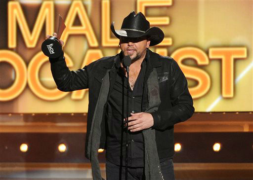Jason Aldean accepts the award for male vocalist of the year at the 49th annual Academy of Country Music Awards at the MGM Grand Garden Arena on Sunday, April 6, 2014, in Las Vegas. &#40;Photo by Chris Pizzello&#47;Invision&#47;AP&#41; <span class=meta>(Photo&#47;Chris Pizzello)</span>