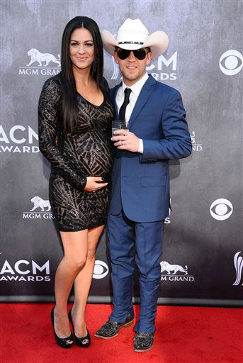 Justin Moore, right, and Kate Moore arrive at the 49th annual Academy of Country Music Awards at the MGM Grand Garden Arena on Sunday, April 6, 2014, in Las Vegas. &#40;Photo by Al Powers&#47;Powers Imagery&#47;Invision&#47;AP&#41; <span class=meta>(Al Powers&#47;Powers Imagery)</span>