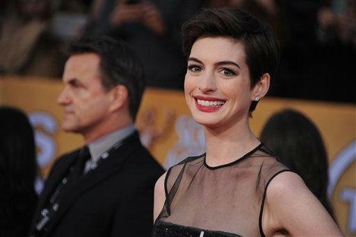 "<div class=""meta ""><span class=""caption-text "">Actress Anne Hathaway arrives at the 19th Annual Screen Actors Guild Awards at the Shrine Auditorium in Los Angeles on Sunday Jan. 27, 2013.  (Photo/Jordan Strauss)</span></div>"
