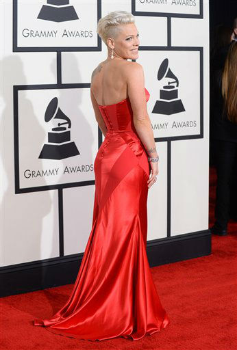 "<div class=""meta ""><span class=""caption-text "">Pink arrives at the 56th annual GRAMMY Awards at Staples Center on Sunday, Jan. 26, 2014, in Los Angeles.   (Photo by Jordan Strauss/Invision/AP)</span></div>"