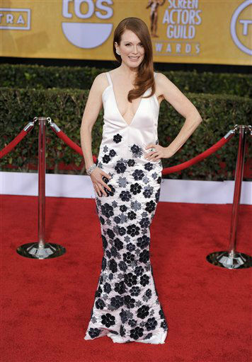"<div class=""meta ""><span class=""caption-text "">Julianne Moore arrives at the 19th Annual Screen Actors Guild Awards at the Shrine Auditorium in Los Angeles on Sunday Jan. 27, 2013.  (Photo/Chris Pizzello)</span></div>"