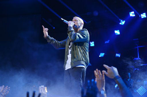 Eminem performs on stage at the MTV Movie Awards, on Sunday, April 13, 2014, in Los Angeles.   <span class=meta>(Photo by John Shearer&#47;Invision for MTV&#47;AP Images)</span>