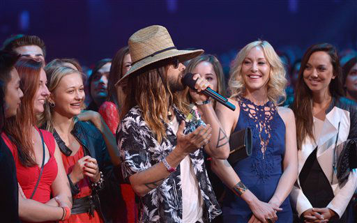 "<div class=""meta image-caption""><div class=""origin-logo origin-image ""><span></span></div><span class=""caption-text""> Jared Leto speaks in audience at the MTV Movie Awards, on Sunday, April 13, 2014, in Los Angeles.   (hoto by John Shearer/Invision for MTV/AP Images)</span></div>"