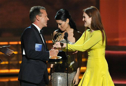 "<div class=""meta ""><span class=""caption-text "">Actor Kiefer Sutherland, left, and actress Julianne Moore, winner of the Emmy for outstanding lead actress in a miniseries or movie for ""Game Change,""  appear onstage at the 64th Primetime Emmy Awards at the Nokia Theatre on Sunday, Sept. 23, 2012, in Los Angeles. (Photo by John Shearer/Invision/AP) (Photo/John Shearer)</span></div>"