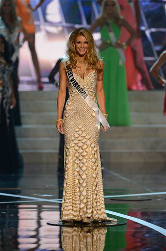 "<div class=""meta image-caption""><div class=""origin-logo origin-image ""><span></span></div><span class=""caption-text"">Miss West Virginia Chelsea Welch walks the runway during the introductions of the Miss USA 2013 pageant, Sunday, June 16, 2013, in Las Vegas.   (AP Photo/ Jeff Bottari)</span></div>"