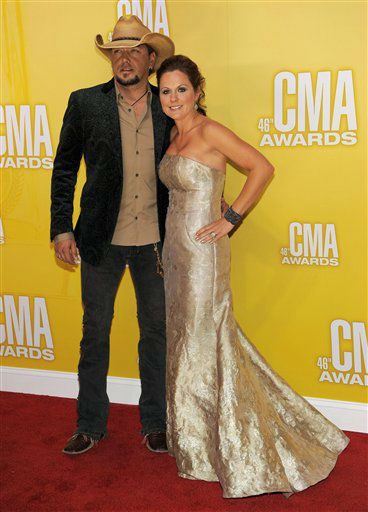 "<div class=""meta ""><span class=""caption-text "">Jason Aldean, left, and Jessica Ussery Aldean arrive at the 46th Annual Country Music Awards at the Bridgestone Arena on Thursday, Nov. 1, 2012, in Nashville, Tenn.  (Photo/Chris Pizzello)</span></div>"