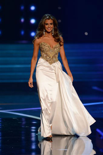 "<div class=""meta image-caption""><div class=""origin-logo origin-image ""><span></span></div><span class=""caption-text"">Miss Connecticut Erin Brady walks the runway during the evening gown competition of the Miss USA 2013 pageant, Sunday, June 16, 2013, in Las Vegas. Erin Brady of South Glastonbury, Conn., won the beauty pageant.  (AP Photo/ Jeff Bottari)</span></div>"
