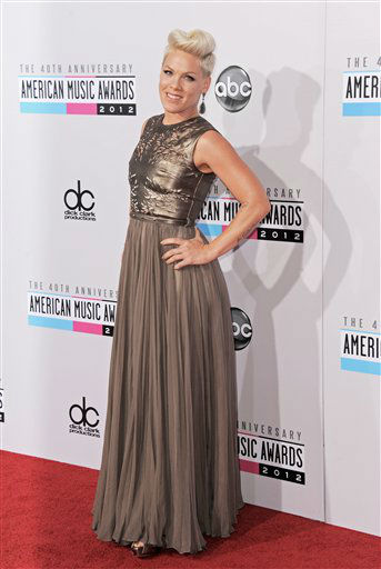 "<div class=""meta ""><span class=""caption-text ""> Pink arrives at the 40th Anniversary American Music Awards on Sunday, Nov. 18, 2012, in Los Angeles. (Photo by Jordan Strauss/Invision/AP)</span></div>"