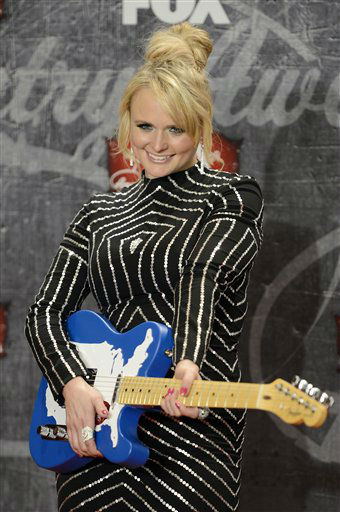 Recording artist Miranda Lambert poses in the press room with her award for Female Single of the Year backstage at the American Country Awards on Monday, Dec. 10, 2012, in Las Vegas. &#40;Photo by Jeff Bottari&#47;Invision&#47;AP&#41; <span class=meta>(Photo&#47;Jeff Bottari)</span>