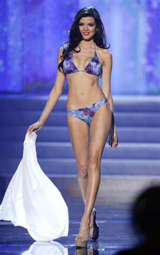 "<div class=""meta ""><span class=""caption-text "">Miss Peru, Nicole Faveron, walks the stage during the swimsuit portion of the Miss Universe competition, Wednesday, Dec. 19, 2012, in Las Vegas.   (AP Photo/ Julie Jacobson)</span></div>"