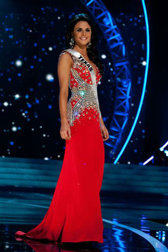 "<div class=""meta image-caption""><div class=""origin-logo origin-image ""><span></span></div><span class=""caption-text"">This photo provided by the Miss Universe Organization, Miss Texas USA 2013, Ali Nugent competes in her evening gown during the 2013 Miss USA Competition Preliminary Show  in Las Vegas  on Wednesday June 12, 2013.  She will compete for the title of Miss USA 2013 and the coveted Miss USA Diamond Nexus Crown on June 16, 2013.   (AP Photo/ Patrick Prather)</span></div>"