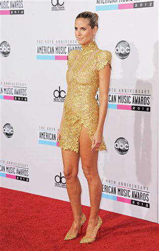 "<div class=""meta ""><span class=""caption-text "">Heidi Klum arrives at the 40th Anniversary American Music Awards on Sunday, Nov. 18, 2012, in Los Angeles. (Photo by Jordan Strauss/Invision/AP)</span></div>"