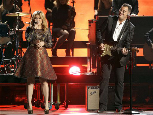 "<div class=""meta ""><span class=""caption-text "">Kelly Clarkson, left, and Vince Gill perform at the 46th Annual Country Music Awards at the Bridgestone Arena on Thursday, Nov. 1, 2012, in Nashville, Tenn.  (Photo/Wade Payne)</span></div>"