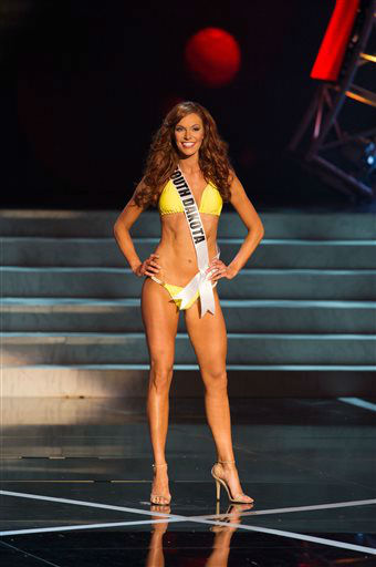 In this photo provided by the Miss Universe Organization,  Miss South Dakota USA 2013, Jessica Albers,  competes in her swimsuit during the  2013 Miss USA Competition Preliminary Show in Las Vegas on Wednesday June 12, 2013.   She will compete for the title of Miss USA 2013 and the coveted Miss USA Diamond Nexus Crown on June 16, 2013.    <span class=meta>(AP Photo&#47; Darren Decker)</span>
