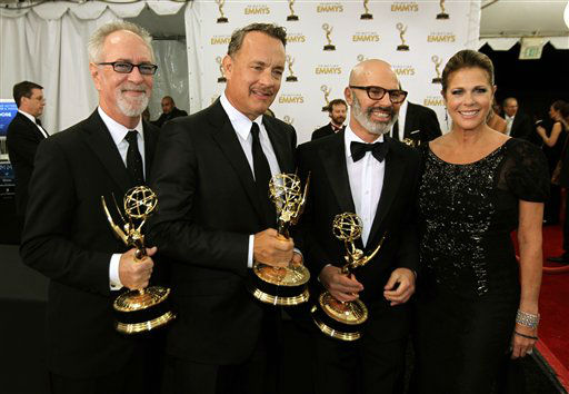 Producers, from left, Gary Goetzman, Tom Hanks and Steve Shareshian, winners of the Emmy for Outstanding Miniseries of Movie for &#34;Game Change&#34; pose with actress Rita Wilson backstage at the 64th Primetime Emmy Awards at the Nokia Theatre on Sunday, Sept. 23, 2012, in Los Angeles. &#40;Photo by Matt Sayles&#47;Invision&#47;AP&#41; <span class=meta>(Photo&#47;Matt Sayles)</span>