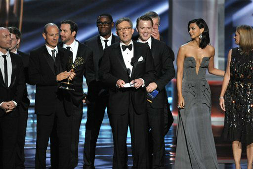 Alex Gansa, center, and the cast and crew of &#34;Homeland&#34; accept the award for outstanding drama series at the 64th Primetime Emmy Awards at the Nokia Theatre on Sunday, Sept. 23, 2012, in Los Angeles. &#40;Photo by John Shearer&#47;Invision&#47;AP&#41; <span class=meta>(Photo&#47;John Shearer)</span>