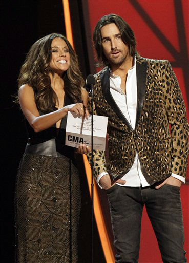 "<div class=""meta ""><span class=""caption-text "">Jana Kramer, left, and Jake Owen present an award onstage at the 46th Annual Country Music Awards at the Bridgestone Arena on Thursday, Nov. 1, 2012, in Nashville, Tenn.  (Photo/Wade Payne)</span></div>"