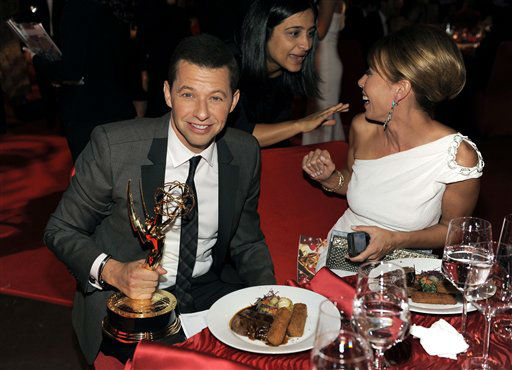 Jon Cryer, with his award for outstanding leading actor in a comedy series for &#34;Two and a Half Men&#34;, left, and wife LIsa Joyner are seen at the 64th Primetime Emmy Awards Governors Ball on Sunday, Sept. 23, 2012, in Los Angeles. &#40;Photo by Chris Pizzello&#47;Invision&#47;AP&#41; <span class=meta>(Photo&#47;Chris Pizzello)</span>