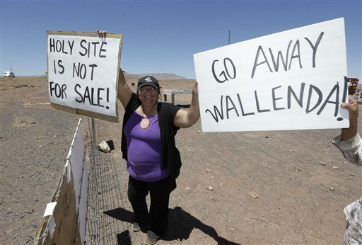 Renae Yellowhorse, a Navajo from Cameron,  gathers with others American Indians along highway, near Cameron, Ariz., on Sunday, June 23, 2013 to protest Florida aerialist Nik Wallenda&#39;s tightrope walk over the Little Colorado River Gorge. Wallenda planned the stunt without a safety harness on the Navajo reservation.   <span class=meta>(AP Photo&#47; Rick Bowmer)</span>