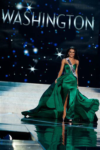 This photo provided by the Miss Universe Organization, Miss Washington USA 2013, Cassandra Searles competes in her evening gown during the 2013 Miss USA Competition Preliminary Show  in Las Vegas  on Wednesday June 12, 2013.  She will compete for the title of Miss USA 2013 and the coveted Miss USA Diamond Nexus Crown on June 16, 2013.   <span class=meta>(AP Photo&#47; Patrick Prather)</span>