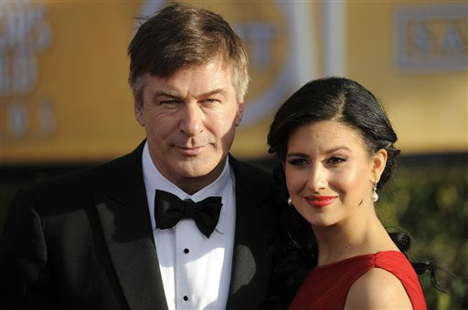 Alec Baldwin, left, and Hilaria Thomas arrive at the 19th Annual Screen Actors Guild Awards at the Shrine Auditorium in Los Angeles on Sunday, Jan. 27, 2013.   <span class=meta>(Photo&#47;Chris Pizzello)</span>