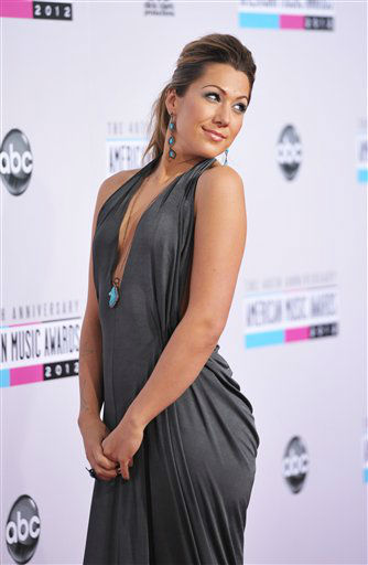 "<div class=""meta image-caption""><div class=""origin-logo origin-image ""><span></span></div><span class=""caption-text""> Colbie Caillat arrives at the 40th Anniversary American Music Awards on Sunday, Nov. 18, 2012, in Los Angeles. (Photo by John Shearer/Invision/AP)</span></div>"