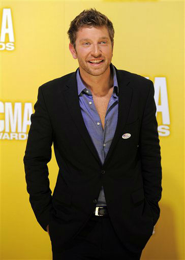 "<div class=""meta image-caption""><div class=""origin-logo origin-image ""><span></span></div><span class=""caption-text"">Brett Eldredge arrives at the 46th Annual Country Music Awards at the Bridgestone Arena on Thursday, Nov. 1, 2012, in Nashville, Tenn.   (Photo/Chris Pizzello)</span></div>"