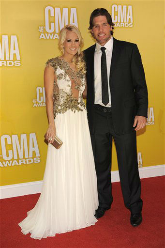 "<div class=""meta ""><span class=""caption-text "">Carrie Underwood, left, and her husband Mike Fisher arrive at the 46th Annual Country Music Awards at the Bridgestone Arena on Thursday, Nov. 1, 2012, in Nashville, Tenn.  (Photo/Chris Pizzello)</span></div>"