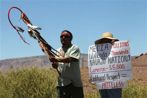Supai Waters, left, a Haeva Supai tribal member and and a woman who wished to be unidentified protest along highway, near Cameron, Ariz., on Sunday, June 23, 2013, to protest Florida aerialist Nik Wallenda&#39;s tightrope walk over the Little Colorado River Gorge. Wallenda plans to do the stunt without a safety harness.   <span class=meta>(AP Photo&#47; Rick Bowmer)</span>