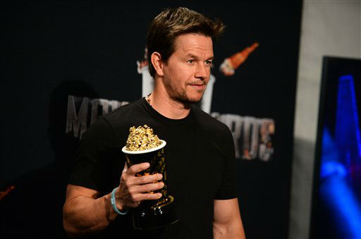 "<div class=""meta image-caption""><div class=""origin-logo origin-image ""><span></span></div><span class=""caption-text""> Mark Wahlberg poses in the press room with his MTV Generation Award at the MTV Movie Awards on Sunday, April 13, 2014, at Nokia Theatre in Los Angeless  (Photo by Jordan Strauss/Invision/AP)</span></div>"