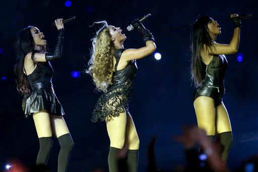 Beyonce, center, Kelly Rowland, right, and Michelle Williams, left, of Destiny&#39;s Child, perform during the halftime show of the NFL Super Bowl XLVII football game between the San Francisco 49ers and the Baltimore Ravens, Sunday, Feb. 3, 2013, in New Orleans.   <span class=meta>(AP Photo&#47; Patrick Semansky)</span>