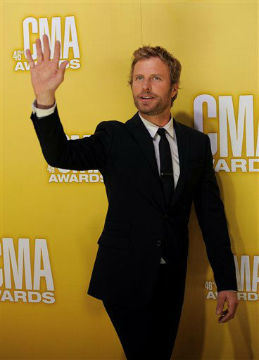 "<div class=""meta image-caption""><div class=""origin-logo origin-image ""><span></span></div><span class=""caption-text"">Dierks Bentley arrives at the 46th Annual Country Music Awards at the Bridgestone Arena on Thursday, Nov. 1, 2012, in Nashville, Tenn.   (Photo/Chris Pizzello)</span></div>"