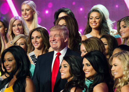 "<div class=""meta ""><span class=""caption-text "">In this photo provided by the Miss Universe Organization, Donald Trump, co-owner of the Miss Universe Organization, poses for a photo with the competitors during rehearsal for the upcoming Miss USA Competition at PH Live in Las Vegas on Saturday, June 15, 2013.  (AP Photo/ Darren Decker)</span></div>"