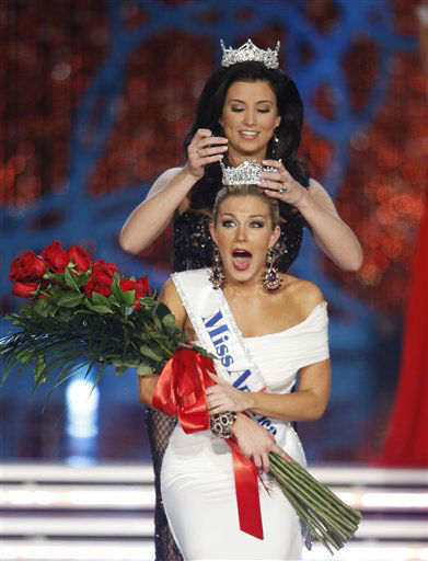 Miss New York Mallory Hytes Hagan is crowned Miss America 2013 by Miss America 2012 Laura Kaeppeler on Saturday, Jan. 12, 2013, in Las Vegas.   <span class=meta>(AP Photo&#47; Isaac Brekken)</span>