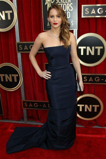 Actress Jennifer Lawrence arrives at the 19th Annual Screen Actors Guild Awards at the Shrine Auditorium in Los Angeles on Sunday, Jan. 27, 2013. &#40;Photo by Matt Sayles&#47;Invision&#47;AP&#41; <span class=meta>(Photo&#47;Matt Sayles)</span>