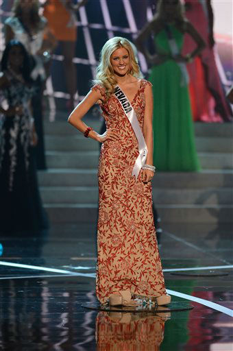 "<div class=""meta image-caption""><div class=""origin-logo origin-image ""><span></span></div><span class=""caption-text"">Miss Nevada Chelsea Caswell, from Las Vegas, Nev., walks the runway during the introductions of the Miss USA 2013 pageant, Sunday, June 16, 2013, in Las Vegas.  (AP Photo/ Jeff Bottari)</span></div>"