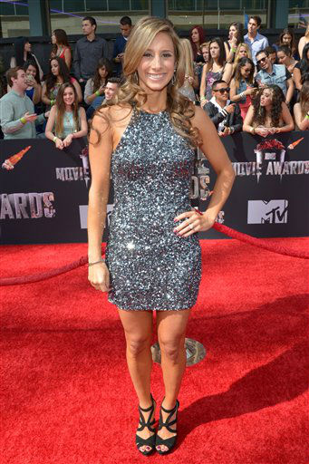 "<div class=""meta image-caption""><div class=""origin-logo origin-image ""><span></span></div><span class=""caption-text"">MTV's Christina Garibaldi arrives at the 2014 MTV Movie Awards, on Sunday, April 13, 2014 in Los Angeles.   (Photo by John Shearer/Invision for MTV/AP Images)</span></div>"