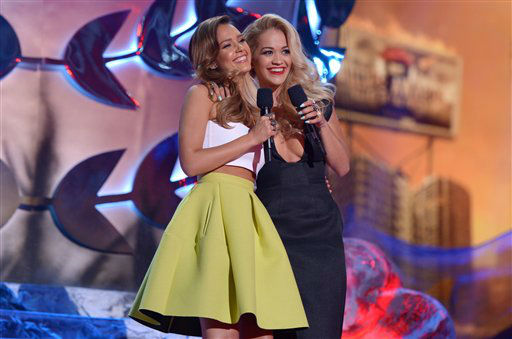Jessica Alba, left, and Rita Ora present the award for best shirtless performance on stage at the MTV Movie Awards, on Sunday, April 13, 2014, in Los Angeles. &#40;Photo by John Shearer&#47;Invision for MTV&#47;AP Images&#41; <span class=meta>(&#40;Photo by John Shearer&#47;Invision for MTV&#47;AP Images&#41;)</span>