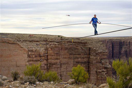 IMAGE DISTRIBUTED FOR DISCOVERY COMMUNICATIONS - Nik Wallenda nears the completion of his 1400 foot walk across the Grand Canyon for Discovery Channel&#39;s Skywire Live With Nik Wallenda on Sunday, June 23, 2013 at the Grand Canyon, Calif.   <span class=meta>(Photo&#47;Tiffany Brown)</span>