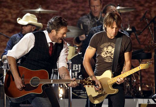 "<div class=""meta ""><span class=""caption-text "">Blake Shelton, left, and Keith Urban perform during a tribute to Willie Nelson at the 46th Annual Country Music Awards at the Bridgestone Arena on Thursday, Nov. 1, 2012, in Nashville, Tenn. (Photo/Wade Payne)</span></div>"